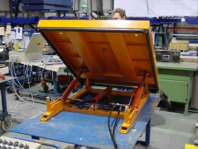 Figure Hydraulic tilting tables in yellow