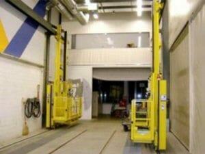 Rail-guided elevating work platforms
