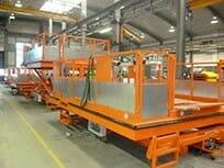 Fahrbare Hubarbeitsbühne in orange